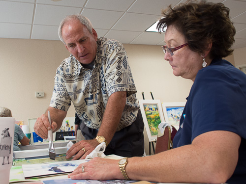 Tom Lynch works with Jane Horst during 2012 watercolor workshop