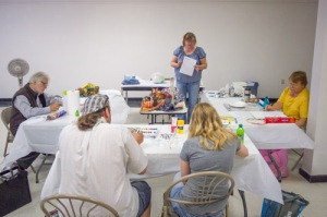 Jean Kellogg and her students during one of her acrylic painting classes.