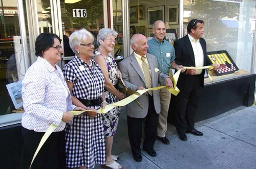 Berkeley Arts Council president Malinda Shaver prepares to cut the ribbon to declare the Berkeley Art Works officially open. Helping out were (L to R) Board Members Anna Howard, Stephanie Godley, Mayor George Karos, Board Member Jeff Poland, and Main Street Martinsburg Director Randy Lewis