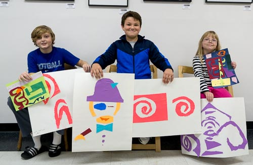 Three budding artists show off their masterpieces created in the first session of the Junior Art Academy at the Berkeley Art Works.