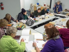 Judith Becker and her students in the Introduction to Colored Pencil Painting Workshop