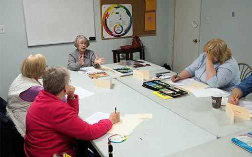 Teaching Artist Judith Becker teaches color theory at the Berkeley Art Works in Martinsburg