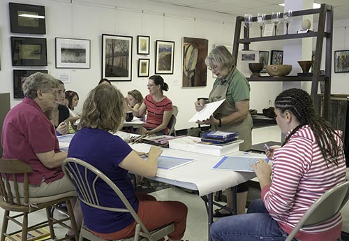 "Judith Becker demonstrates color pencil techniques to a group of budding artists as part of the Berkeley Art Works ""Mini-Lesson"" series."