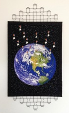 """HONORABLE MENTION """"Deporting the Doves of Peace"""" by Carol Williams; 7 metal hot-air balloon buttons, 17 resin dove buttons, cotton fabrics, black wire fencing; NFS (22W x 45H)"""