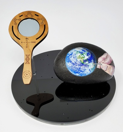 """Self Portrait of the Sentient Earth"" by Juliet Hossain; Acrylic paint on rock, cherry wood, black and clear acrylic; $150 (8inx5inx8in)"