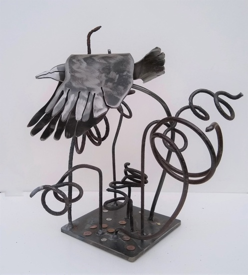 """Wren Leaving the Forest Floor: by Sally Myers; Welded steel, steel springs, rivets; $310 (10 inches x 11 inches x 10 inches)"