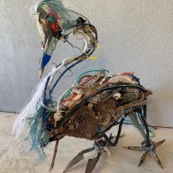 """War Heron III"" by Tracey Donnelly Franklin; Grenade pins, cover-smoke can,wasp nest, wire, snake shed, animal skulls,antler,tent cord,bumpe; $1,700 (36H x 40L x 17W)"